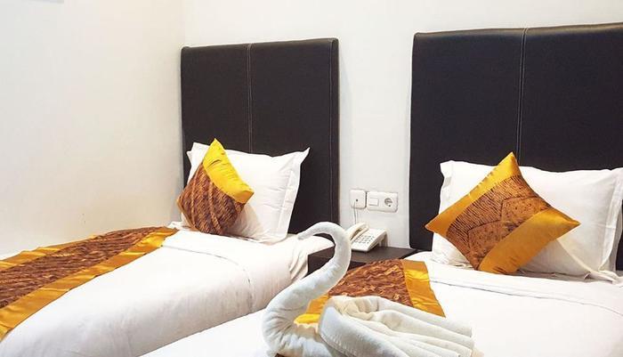 Sunrise Hotel Yogyakarta Yogyakarta - Ruang nyaman dengan 2 tempat tidur