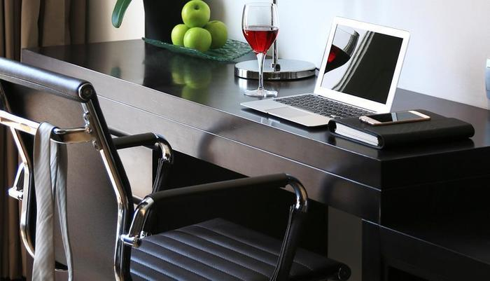 Delonix Hotel Karawang - Writing desk in the room