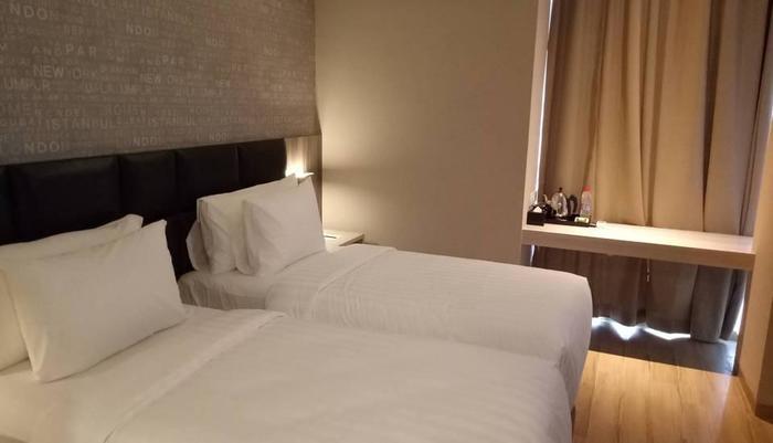 Luminor Hotel Jambi Kebun Jeruk Jambi - Deluxe Room dengan Twin Bed