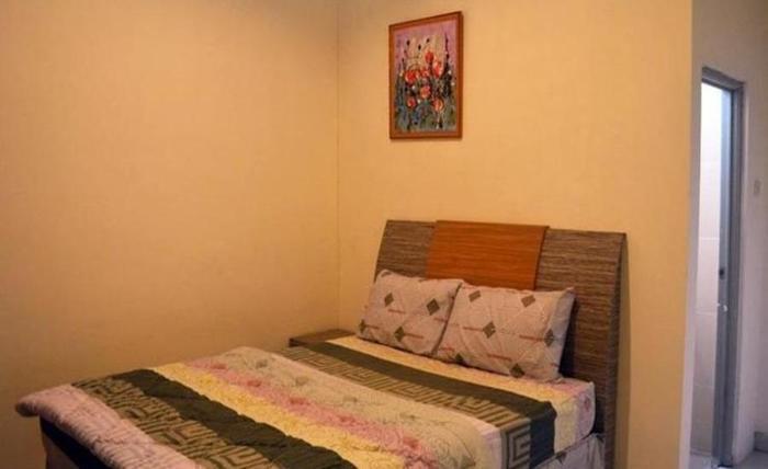 Sutos Guest House Bangka - Kamar tamu