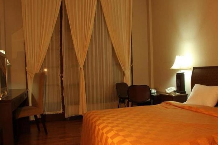Campago Resort Hotel Padang - Kamar tamu