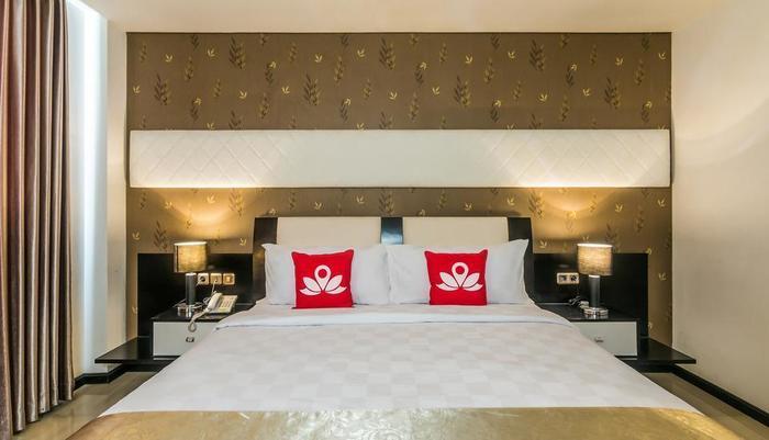 ZenRooms Denpasar Marlboro - Tampak tempat tidur double