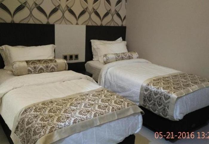 Malang City Boulevard Homestay & Restaurant Malang - Deluxe Twin
