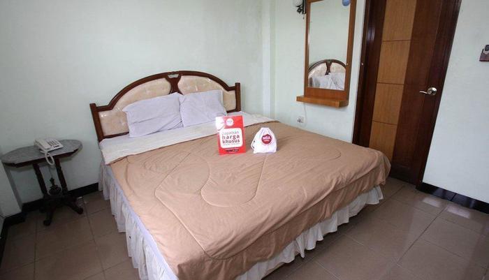 NIDA Rooms Purna MTQ Pekanbaru - Kamar tamu