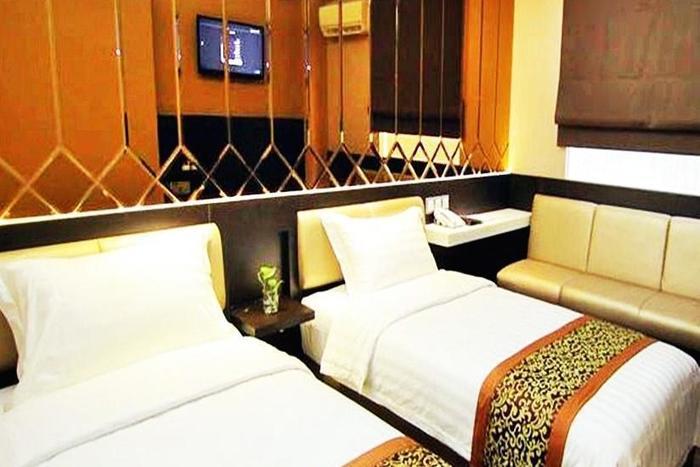 Favor Hotel Makassar - Kamar Deluxe