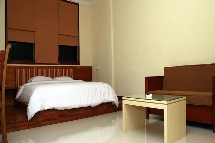 Home Inn Palembang - Kamar Junior Suite