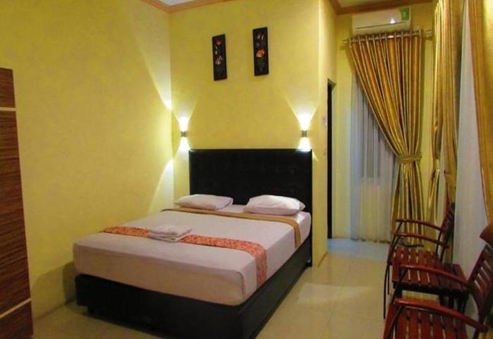 Golden Vella Hotel Bangka - Kamar tamu
