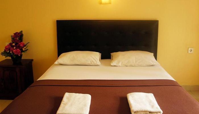 Waringin Homestay Bali - Kamar tidur