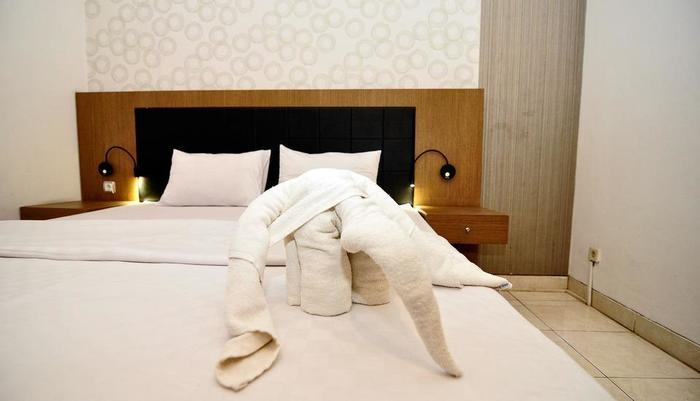 MGriya Guest House Purwokerto - Superior tempat tidur kamar