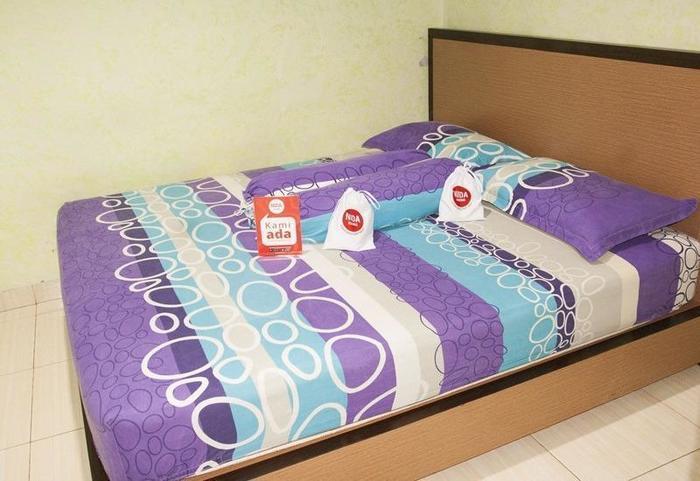 NIDA Rooms Nipah Padang Barat - Kamar tamu