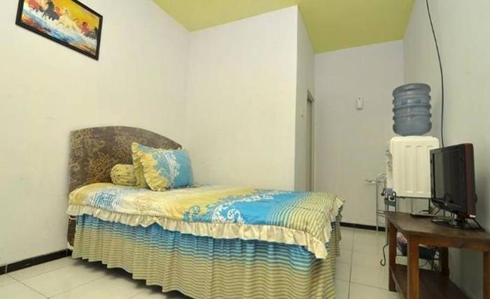 Novi Homestay Malang - Kamar tamu