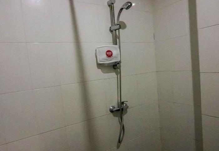 NIDA Rooms Legian Discovery Kuta - Kamar mandi