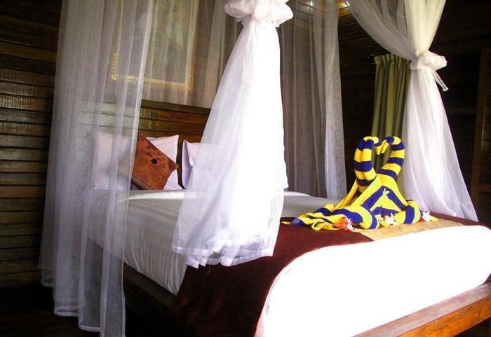 Dmas Huts Lembongan Bali - Kamar tidur Deluxe