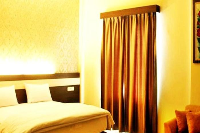 Guest Hotel Manggar Manggar - Kamar Tamu