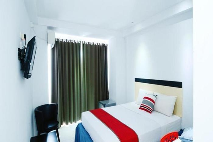 Hotel Prince Boulevard Manado - Kamar tamu