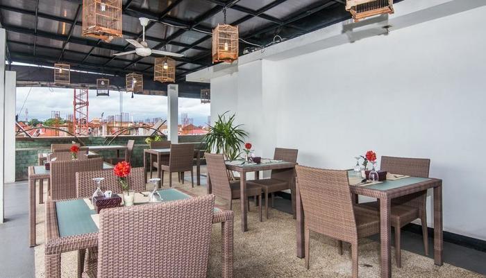 ZenRooms Legian Troppozone Thematic Bali - Restoran