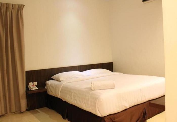 Ameera Hotel Pekanbaru - Kamar tamu