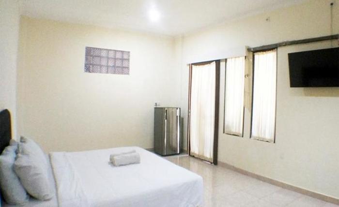 Villa Happy Jimbaran Bali - Tempat tidur double - Kamar Deluxe