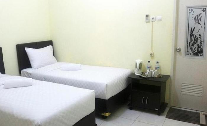 Hasian Malioboro Motel Jogja - Kamar tamu