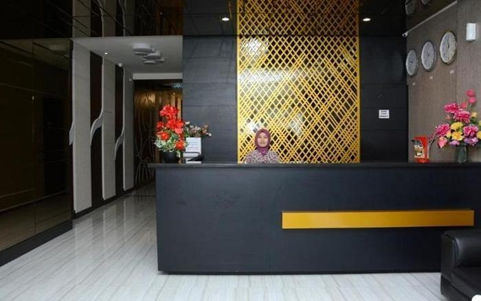 D'Hotel Holiday Makassar Makassar - Reception