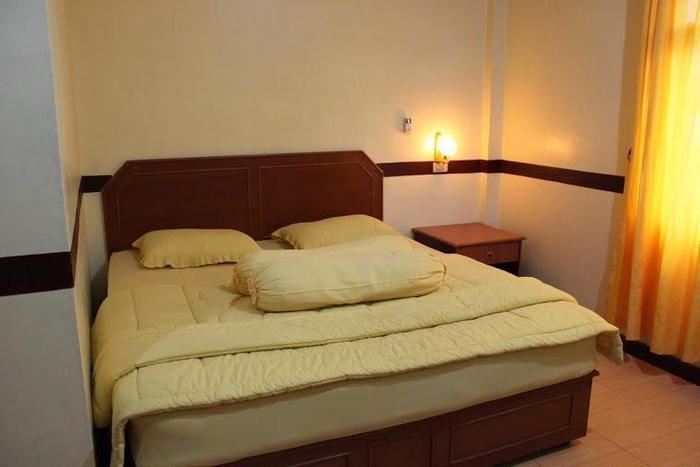 Grand Blang Asan Hotel Pidie - Tempat tidur single kamar deluxe