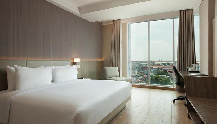 Hotel Santika Radial Palembang - Deluxe Tempat Tidur King