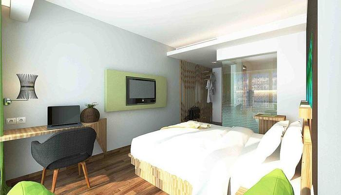 MaxOneSuites at Kuta Tuban - Happines Room
