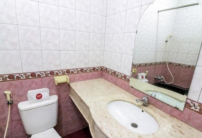 NIDA Rooms Makassar Savu - Kamar mandi