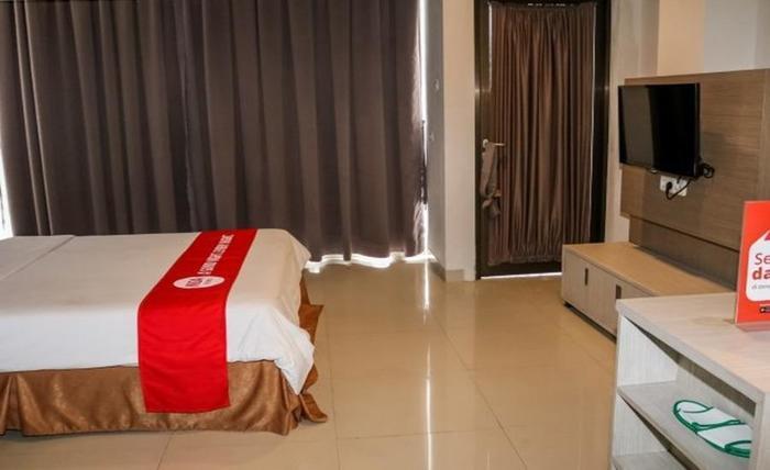 NIDA Rooms Wuruk 1 Central Jakarta - Kamar tamu