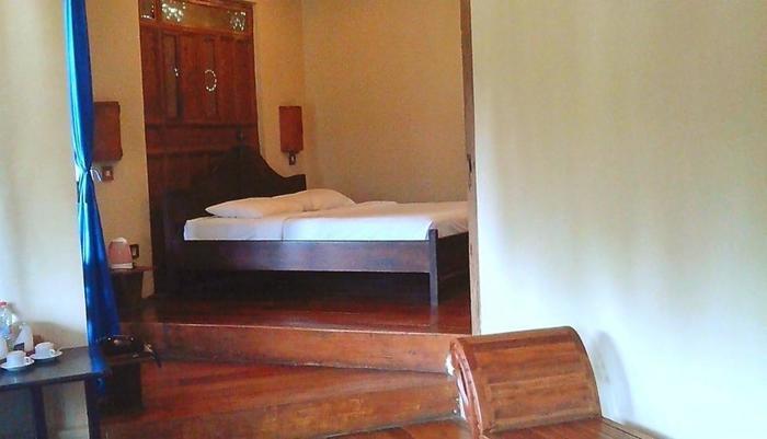 Sapu lidi Resort Hotel Bandung - Kamar tidur Suite Pemandangan Danau