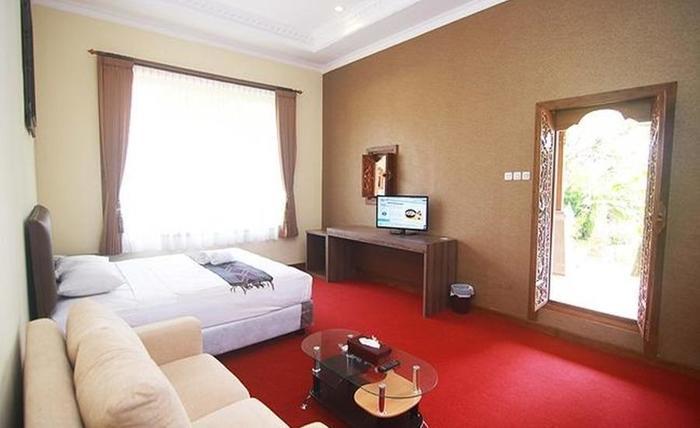 Ubud Hotel & Cottages Malang Malang - Kamar tamu