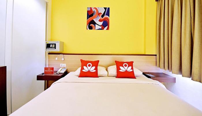 ZenRooms Kuta Sentral Parkir 2 Bali - Tampak tempat tidur double