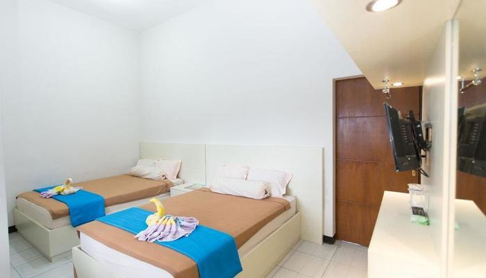 Batuque Town Villa Malang - family room