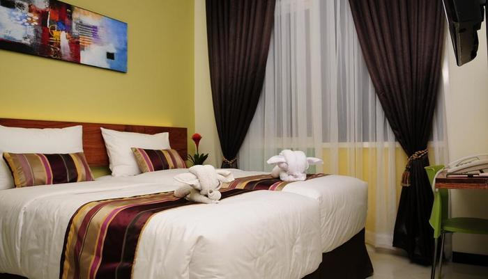 BIZ Boulevard Hotel Manado - Kamar Deluxe Twin