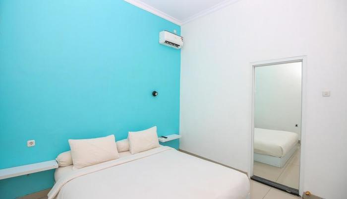 Golden Snail Guest House Balikpapan - Room