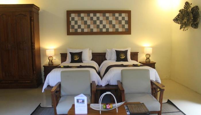 Ashoka Tree Resort at Tanggayuda Bali - Tempat tidur kembat