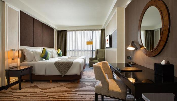 Swiss-Belboutique Yogyakarta - Deluxe Room Green Style