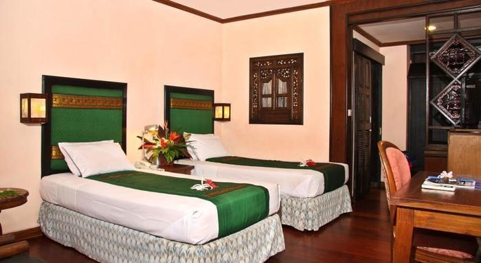 Peneeda View Beach Hotel Bali - Kamar Tidur