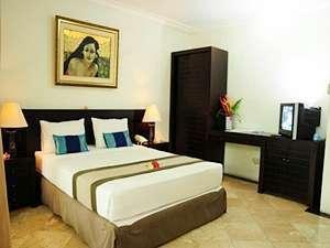 Mirah Hotel Banyuwangi - Deluxe Bedroom