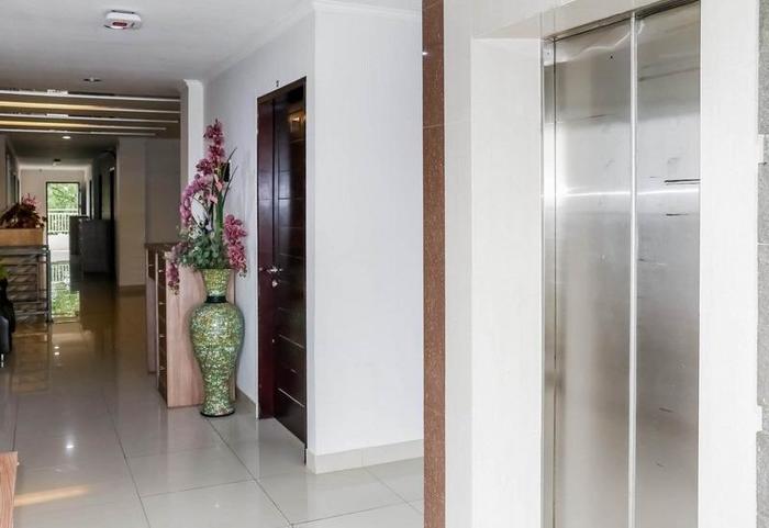 NIDA Rooms Titiran Ruman Cibaduyut Bandung - Mengangkat