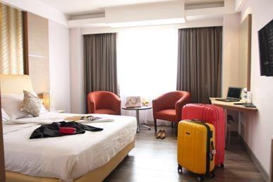 Hotel Orchardz Industri Jakarta - Kamar Deluxe baru