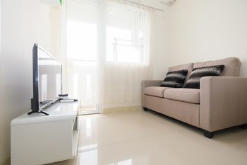 2 Bedrooms at Green Pramuka City Apartment By Travelio
