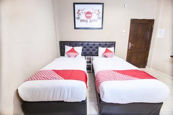 OYO 519 Coin Mulia Hotel Serdang Bedagai - Deluxe Twin Room Regular Plan