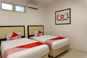 OYO 916 Bintara Guest House Pekanbaru - Deluxe Twin Room Regular Plan