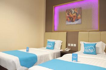 Airy Kuantan Raya 120 Pekanbaru - Deluxe Twin Room with Breakfast Special Promo Jan 5
