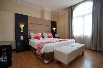 Capital O 1128 Hotel Imara Palembang - Suite Family Regular Plan