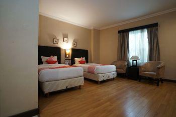 Capital O 1128 Hotel Imara Palembang - Suite Twin Regular Plan