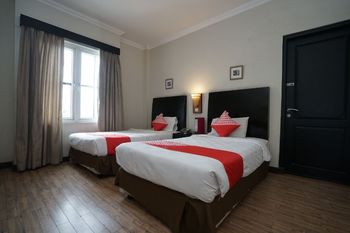 Capital O 1128 Hotel Imara Palembang - Standard Twin Room Regular Plan
