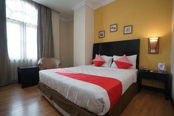 Capital O 1128 Hotel Imara Palembang - Standard Double Room Regular Plan