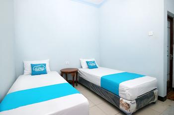 Airy Eco Syariah Bandara Juanda Letjen Wahono 25 Sidoarjo - Standard Twin Room Only Special Promo Sep 45